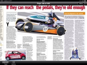 A newspaper article about the two greenpower cars.